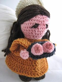 Crocheted amigurumi doll of   St. Agatha who had her breasts chopped off rather than not save her virginity for Jesus.