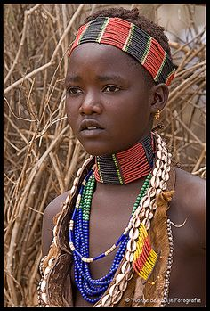 Africa   A young Hamar girl, so pretty, wearing traditional jewellery. The Hamar are very kind and the market in Turmi is a wonderful place to get lost for a while! Location: Turmi Market Oromya Ethiopia   Image and caption © Mama Africa Photography ~ Yvon de Bruijn