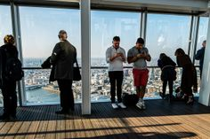 Not sure if this really counts as Street Photography, the background is more urban except that it still includes people. Another 'two out, two in' sort of shot.  ~Rob Andrews - The View From the Shard 3 via Flickr