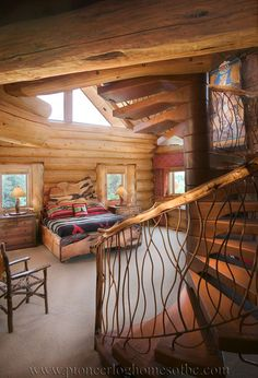 Log bedroom with staircase (Pioneer Log Homes of BC)