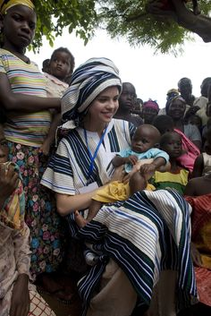 UNICEF Ambassador Selena Gomez sits with children in Tingoli, Ghana on September 5, 2009. © Jane Hahn