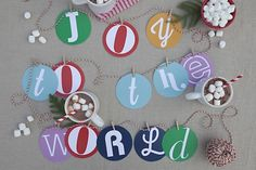 happy anything garland by melanieblodgett for Julep  how about this for a happy birthday banner?  idk about the mixed fonts, but I like the red/white bakers twine and we could do the circles in Kraft paper with white letters or the colors of the party hats?