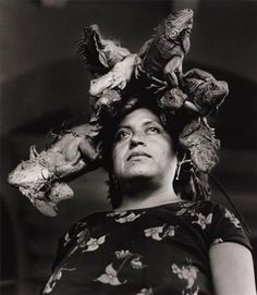 Woman wears a hat made of live Iguanas, 1979