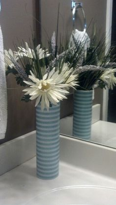 Recycled pringles can into a pretty vase.  Or you can do the same thing use it for raw spaghetti or cookie.