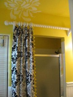 I love this idea of covering up the old glass shower door.