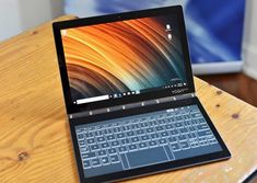 Lenovo's folding Yoga Book features the first E Ink keyboard Small Computer, Gaming Computer, Laptop Computers, Gaming Setup, Gadgets And Gizmos, Tech Gadgets, Yoga Books, Iphone Accessories, Mobile Accessories