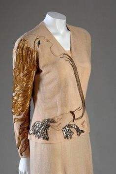 Schiaparelli, 1937.  Note embroidery, based on one of the sketches Jean Cocteau was (partly!) famous for...