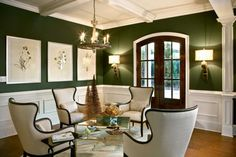 Stylish Living Rooms The Refleshing Charm Of Green With Green Wall  Chandelier Four Chairs Stainlees Table Three Wall Art Wooden Floor