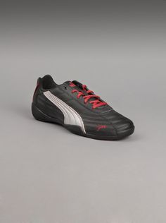 af6e48599325 Puma Junior Tune Cat B Shoes in Black Red. Your little man will love