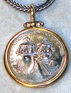 Coin Replica Pendant by Konstantino Sterling silver and 18-karat yellow gold. The image on the frontside is of Heraclios with Heraclios Constantine (Constantine III). The image on the reverse side is of the Christian cross. Size: 7/8 in diameter. Can be used as a pendant or as a charm. Comes in a blue cloth, Konstantino pouch, along with a jewelry cleaning cloth & artist bio Made in Greece.
