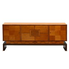 Stunning Swedish Art Deco Credenza in birch and mixed woods, ca. 1930's. Center section with pull out drawers and shelves on either side. (hva)
