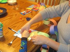 Make a Paper Chain of Gratitude for Thanksgiving.