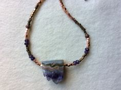 Amethyst Druzey, amethyst and copper beads. By Barbara Disbrow