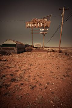 """In Bluewater, New Mexico.  Along """"old Route 66"""" outside Grants.  As in many of these old motels, the motel itself has long been closed.  Now this one houses used cars.  Shot with a Canon 30D with a 10-22mm lens opened to 10."""