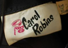 Carol Robins - vintage clothing label with a world of sophistication and intrigue suggested by the wine glass and masquerade mask