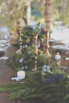 cedar, blue berries, brass candlesticks