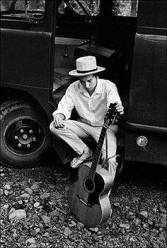 Bob Dylan on his equipment truck outside his Byrdcliff home in Woodstock, NY, 1968. Classic photo by Elliott Landy.