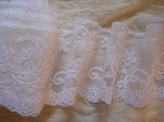 wide lace netting frothy white    $5