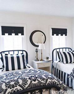 Designer Tom Stringer painted the headboards of these twin beds navy blue, then topped them with duvet covers from Anthropologie. Ngoc Minh Ngo  - HouseBeautiful.com