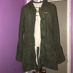 Green hollister coat Long green hollister jacket with fur on the inside . Size xs Hollister Jackets & Coats