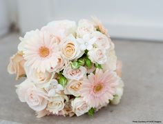 Pale shades of peach, pink and ivory roses are so romantic together. Gerberas add a fun twist. The stephanotis with pearl centers are a classic wedding flower.  They all combine to create one beautiful bouquet. Flowers by Studio B Floral Designs.  Image Courtesy of Kage Imagery