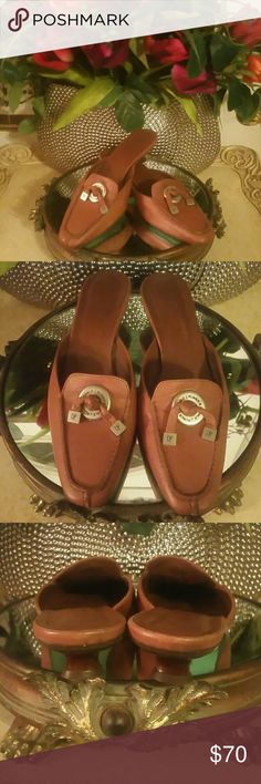 DONALD PLINER BROWN MULES Up for consideration is this pre-owned pair of brown mules with silver accents. These shoes are cute with jeans  or a long skirt. The soles have extra love see pic 4. This does not destroy their beauty. They are in good condition and ready to wear. Donald J. Pliner Shoes Mules & Clogs
