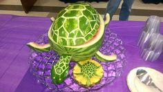Sea turtle watermelon bowl with baby turtle - one tip... after you carve fruit like this, spray a paper towel with a little veg oil and give the outside a rub down... makes it shine nice and last longer... this one was used for a couple days without significant wilting (wrapped tight in plastic wrap and refrigerated between uses of course)
