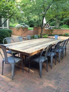 Outdoor, patio rustic farm tables--we'll make you one! I think this is what we are going to have to do to find an outdoor table to fit our large family! I love it!