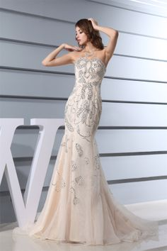 This amazing champane wedding dress is just for your big day! It's made of satin and organza. Artful strapless neckline and mermaid silhouette. Nice beadings are decorated on the whole dress. Puddle train and hidden zipper closure. Only the wedding dress is for sale, no other accessories included.