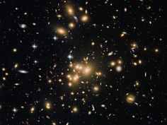 Astronomers have spotted a surprisingly dusty little galaxy within the cluster Abell 1689, shown here in an image by the Hubble telescope. A object from the very early universe is bafflingly rich with dust that theory says shouldn't have formed yet. A galaxy that shouldn't exist. http://news.nationalgeographic.com/news/2015/03/150302-black-hole-blast-biggest-science-galaxies-space/