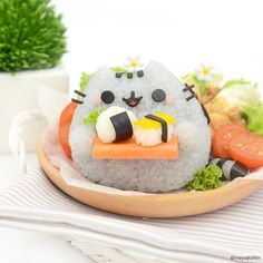 Pusheen the Cat rice ball holding mini sushi