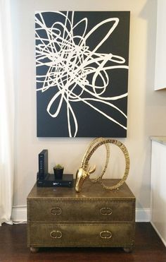 """Original painting on 1.5"""" gallery wrapped canvasby Gina Julian. A strong black and white graphic will add impact to your space! Painting continues around edges"""