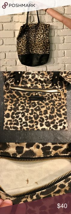 Rebecca Minkoff Leopard Tote Bag Rebecca Minkoff Leopard Print Tote Bag. Gold hardware. Inside zip pocket. Leopard fabric is like a canvas. Black leather straps, details, and bottom panel. Well loved but minimal wear and still has lots of life, small stain on inside zip pocket and some wear on the leather straps. Rebecca Minkoff Bags Totes