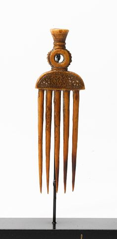 Africa | Old hair comb from the Asante people of Ghana | Elephant Ivory; caramel patina