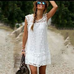 NEW White Dress Adorable white lace dress with poms around the neck and arm holes.  Never worn. Dresses Mini