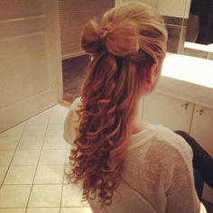 Hair bow.. Put hair half up and pull hair that is in tie up like a bun but leave some hair as a tail out.  Wrap the tail around the middle of the bun breaking it in half !! bow!!