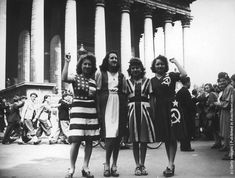 A group of women wearing dresses representing flags of the Allied powers (left to right: the USA, France, Britain and the Soviet Union) outside the Eglise de la Madeleine on VE Day in Paris, 8th May 1945. (Photo by Keystone/Hulton Archive/Getty Images)