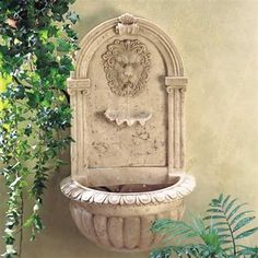 Lion Head Water Fountain.  Mount this classically styled fountain on any wall to recreate the elegant ambience of a Greco-Roman sanctuary. The look of carved stone without the weight and expense! #lion #lionhead #wallfountain #fountain #gardenfountain