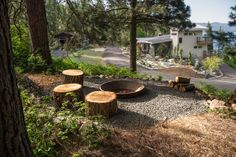 Just a short hike from the house, another fire pit area is ready for an intimate gathering. Cut tree stumps and a concrete crusher cone set the scene for a cozy evening.