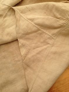 This is a detail of the left underarm gusset. There is a separate piece sewn into the middle of the gusset. This seems like a strange place to wear a hole and likewise seems like a strange place to have a hole in a scrap of linen if you are piecing. The linen of the patch is made of a much finer and whiter linen than the rest of the shirt. — with Tony Holbrook at Department of the Geographer to the Army, 1777-1783.