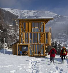 Casa Solare by Studio Albori Positioned to overlook the Aosta Valley near the village of Vens, Italy, 'Casa Solare' is set 1,750 meters above sea level. front of the building consists of an exposed weight-bearing frame made from locally sourced larch timber. open frame allows inhabitants to view from Monte Emilius to massif of Gran Paradiso and Grivola. house is self-sustaining, drawing energy from its solar panels on roof, while owners cook their meals on wood burning stove on the ground…