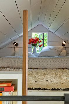 Ceilings play a big part in bedroom coziness. In this case the small loft space underneath the pitched roof transforms into a sweet sleeping space.