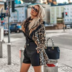 Get this look: http://lb.nu/look/8965796  More looks by Vera Hutterer: http://lb.nu/lalablonde  Items in this look:  Bvlgari Diva's Dream Sunglasses, Mister*Lady Black Top, Guess Black Shorts, Guess Leopard Fake Fur Coat, Liu Jo Black Bag   #chic #elegant #street #cute #feminine #minimal #simple #romantic #layers