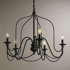 Over dining table? One of my favorite discoveries at WorldMarket.com: Rustic Wire Chandelier