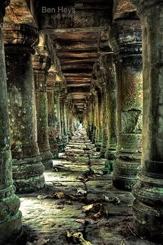 Long stone corridor in temple ruins around Siem Reap, Cambodia. Travel photography around SE Asia photography travel Cambodia. Abandoned Buildings, Abandoned Mansions, Old Buildings, Abandoned Places, Magic Places, Temple Ruins, Hindu Temple, Ancient Ruins, Belle Photo