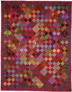 Gorgeous Kaffe Fassett quilt. Saturated with color, amazing use of striped fabric around the edges.