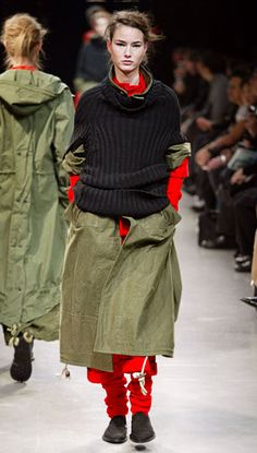 I think I might adopt this fashion trend next fall. Sweatpants under skirts! Brilliant.