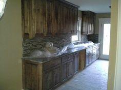 Birch raised panel with granite tops.