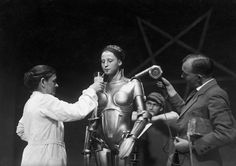 On the set of Fritz Lang's Metropolis — the actress inside the Maria robot taking a breather.