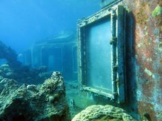 """Abandoned underwater restaurant in Israel - It used to be """"the only the underwater bar and restaurant in the world"""". Situated in the Israeli Red Sea resort town of Eilat, it was built 5 meters (16 feet) below the surface of the sea and 70 meters (230 feet) away from the shore. 23 windows surrounding the restaurant allowed its guests to enjoy a panoramic view of the seabed. The restaurant operated as a strip club for a while until it finally shut down in 2012…"""